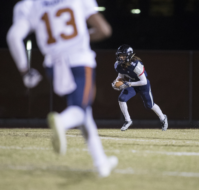 Elisha Young (2) advances the ball as Marcellous McCoy (13) runs towards him during a Legacy High School Shadow Ridge High School game at Legacy High School in North Las Vegas on Friday, Nov. 4, 2 ...