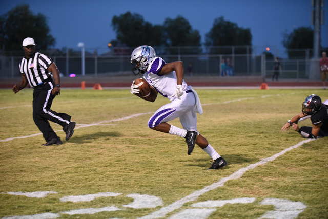 Silverado's Tyreese Newsome-Johnson (4) runs a fumble recovery for a touchdown against Desert Oasis during their football game played at Desert Oasis football field in Las Vegas on Friday, Sept. 9 ...