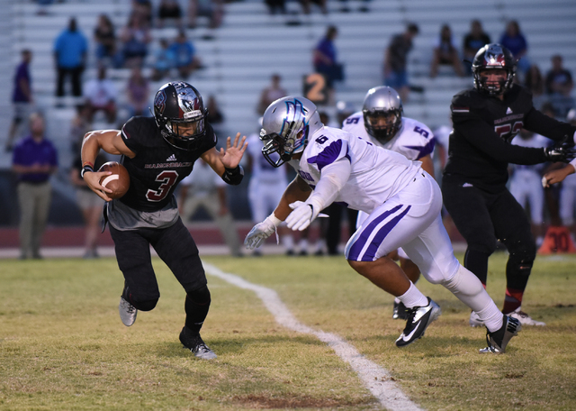 Desert Oasis Jaden Mitchell (3) runs the ball against Silverado's Jordan Walker (6) during their football game played at Desert Oasis football field in Las Vegas on Friday, Sept. 9, 2016. Martin S ...