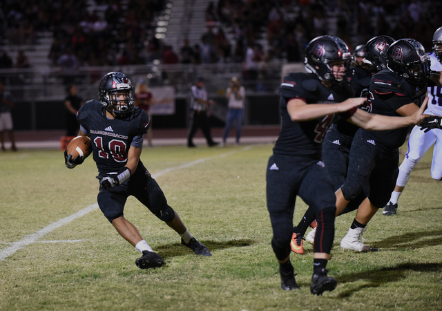 Desert Oasis Cordell Wooten (10) runs the ball against Silverado's defense during their football game played at Desert Oasis football field in Las Vegas on Friday, Sept. 9, 2016. Martin S. Fuentes ...