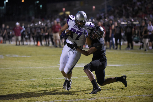 Silverado's Devin Ross (87) scores atouchdown against Desert Oasis Jason Sanders (9) during their football game played at Desert Oasis football field in Las Vegas on Friday, Sept. 9, 2016. Martin  ...
