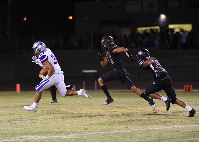 Silverado's Keikiokalani Misipeka (34) runs down field for a touchdown against Desert Oasis defense during their football game played at Desert Oasis football field in Las Vegas on Friday, Sept. 9 ...