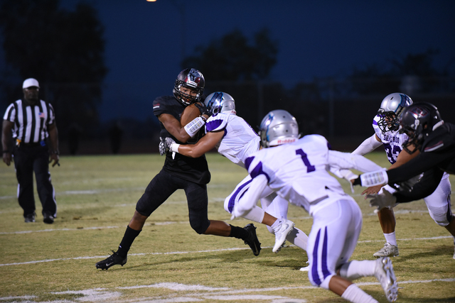 Desert Oasis Jason Sanders (9) is tackled by Silverado's Pekelo Solomon (8) during their football game played at Desert Oasis football field in Las Vegas on Friday, Sept. 9, 2016. Martin S. Fuente ...