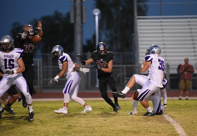 Desert Oasis Jayden Nersinger (33) blocks the field goal attempt of Silverado's Wyland Konkel (35) during their football game played at Desert Oasis football field in Las Vegas on Friday, Sept. 9, ...