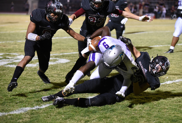 Silverado's Nahzi Salih (9) is tackled by Desert Oasis Tyler Streicher (30) during their football game played at Desert Oasis football field in Las Vegas on Friday, Sept. 9, 2016. Martin S. Fuente ...