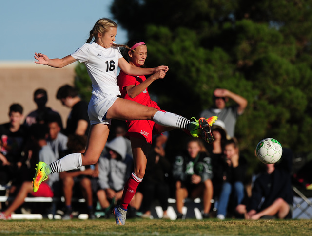 Palo Verde forward Macee Barlow (16) advances the ball against Arbor View defender Samantha Blanchard during their prep soccer game at Palo Verde High School in Las Vegas, Wednesday, Oct. 19, 2016 ...