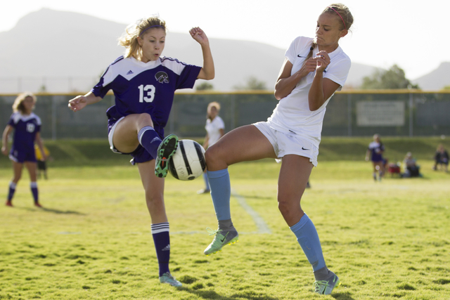 Silverado's Haley Meyer (13), left, fights for ball possession against Foothill's Amber Risheg (2) in the girl's soccer game at Foothill High School on Thursday, Sept. 22, 2016, in Las Vegas. Foot ...