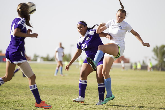 Foothill's Aqua Williams (13), right, makes a pass with coverage from Silverado's Melina Amador (20) in the girl's soccer game at Foothill High School on Thursday, Sept. 22, 2016, in Las Vegas. Fo ...
