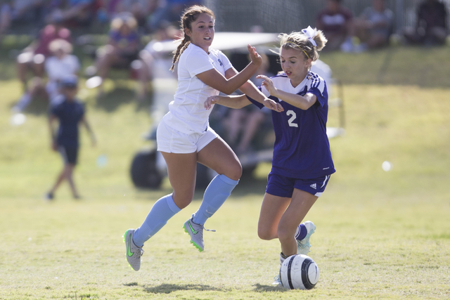 Foothill's Amanda Carducci (6), left, runs with the ball with coverage from Silverado's Chase Jenkins (2) in the girl's soccer game at Foothill High School on Thursday, Sept. 22, 2016, in Las Vega ...