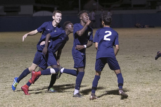 Foothill forward Reagan Mugume, third left, celebrates with teammates after scoring a goal against Green Valley during a varsity soccer game at Green Valley High School on Thursday, Oct. 13, 2016. ...