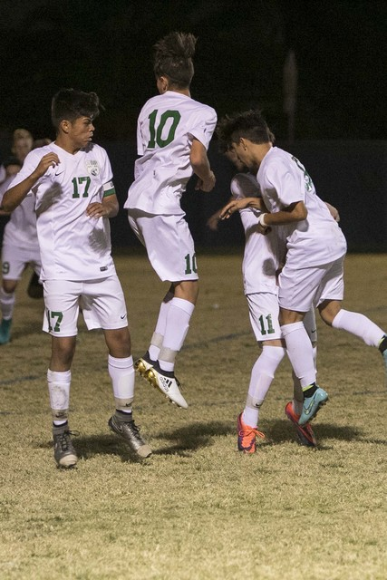 Green Valley defenders block a free kick from Foothill's Reagan Mugume during a varsity soccer game at Green Valley High School on Thursday, Oct. 13, 2016. Richard Brian/Las Vegas Review-Jo ...