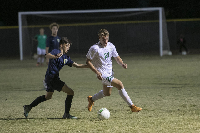 Green Valley forward Cole Aronson (21) is pressured by Foothill's Kade Killian during a varsity soccer game against Foothill at Green Valley High School on Thursday, Oct. 13, 2016. Richard Brian/L ...