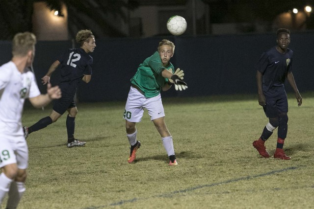 Green Valley goalkeeper Deven Scott (20) throws the ball to a teammate during a varsity soccer game against Foothill at Green Valley High School on Thursday, Oct. 13, 2016. Richard Brian/Las Vegas ...