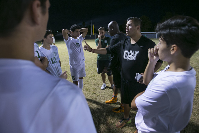 Green Valley soccer coach Jacob Rivera, second right, talks to his players at halftime during a varsity soccer game against Foothill at Green Valley High School on Thursday, Oct. 13, 2016. Richard ...