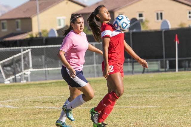 Western's Ellyson Reynada (2) controls with her chest against Cheyenne's Soraya Gonzalez during a varsity soccer game at Cheyenne High School on Monday, Oct. 17, 2016. Richard Brian/Las Vegas Revi ...