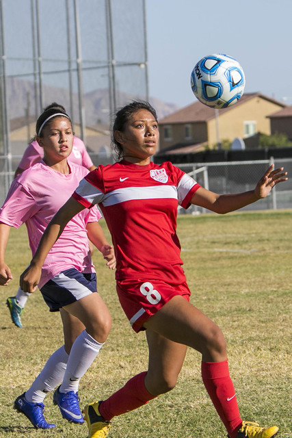 Western's Vanessa Margarito (8) looks to gain control of the ball as she is chased by Cheyenne's Emely Torres (9) during a varsity soccer game at Cheyenne High School on Monday, Oct. 17, 2016. Ric ...