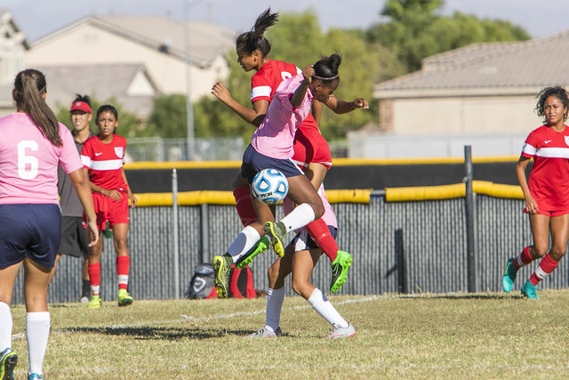 Cheyenne's Mya Heard, front center, and Western's Ellyson Reynada, top center, jump as they vie for a loose ball during a varsity soccer game at Cheyenne High School on Monday, Oct. 17, 2016. Rich ...