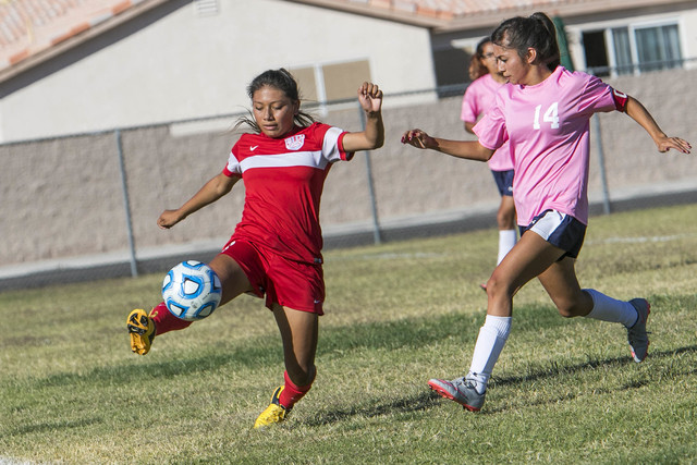 Western's Vanessa Margarito (8) tries to keep the ball in bounds as she is chased by Cheyenne's Laura Garcia (14) during a varsity soccer game against Cheyenne High School on Monday, Oct. 17, 2016 ...