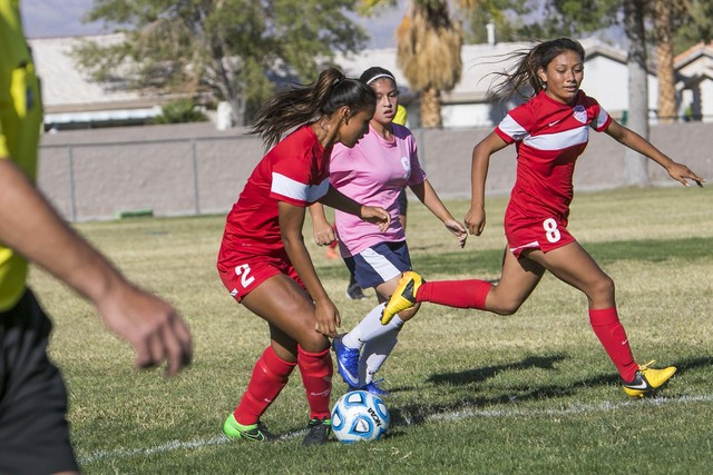 Western's Ellyson Reynada (2) passes to teammates Vanessa Margarito (8) during a varsity soccer game against Cheyenne High School on Monday, Oct. 17, 2016. Richard Brian/Las Vegas Review-Journal F ...