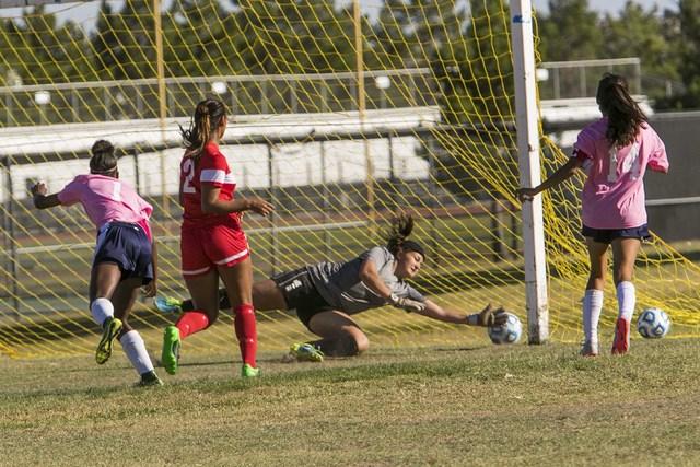 Cheyenne goalkeeper Shayna Thompson, second right, blocks a shot from Western's Ellyson Reynada (2) during a varsity soccer game at Cheyenne High School on Monday, Oct. 17, 2016. Richard Brian/Las ...