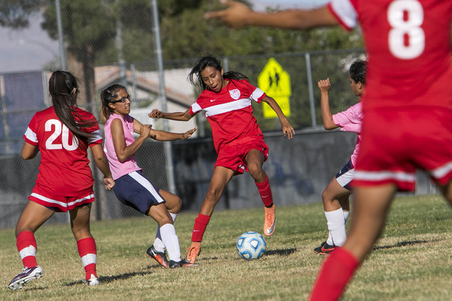 Western's Geraldi Gomez, center, dribbles by Cheyenne's Yadira Erives, second left, during a varsity soccer game at Cheyenne High School on Monday, Oct. 17, 2016. Richard Brian/Las Vegas Review-Jo ...