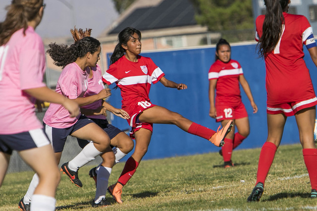 Western's Geraldi Gomez (18) passes to a teammate as she is pressured by during a varsity soccer game at Cheyenne High School on Monday, Oct. 17, 2016. Richard Brian/Las Vegas Review-Journal Follo ...