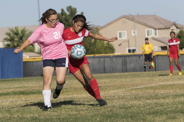 Cheyenne's Jessica Mercado (21) and Western's Kirsten Molina vie for a ball during a varsity soccer game at Cheyenne High School on Monday, Oct. 17, 2016. Richard Brian/Las Vegas Review-Journal Fo ...