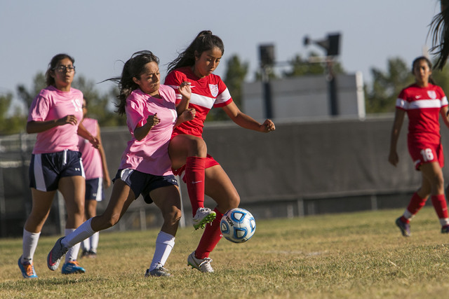Cheyenne's Laura Garcia, second left, and Western's Adelina Jasso vie for a ball during a varsity soccer game at Cheyenne High School on Monday, Oct. 17, 2016. Richard Brian/Las Vegas Review-Journ ...