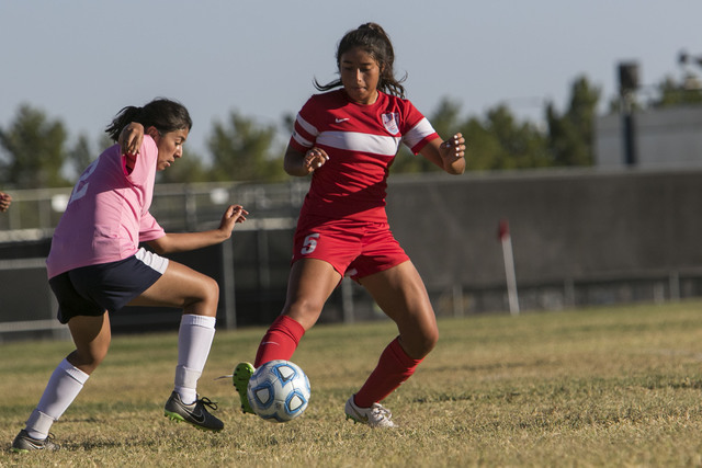 Cheyenne's Bianca Navarro (12) and Western's Adelina Jasso (5) vie for a ball during a varsity soccer game at Cheyenne High School on Monday, Oct. 17, 2016. Richard Brian/Las Vegas Review-Journal  ...