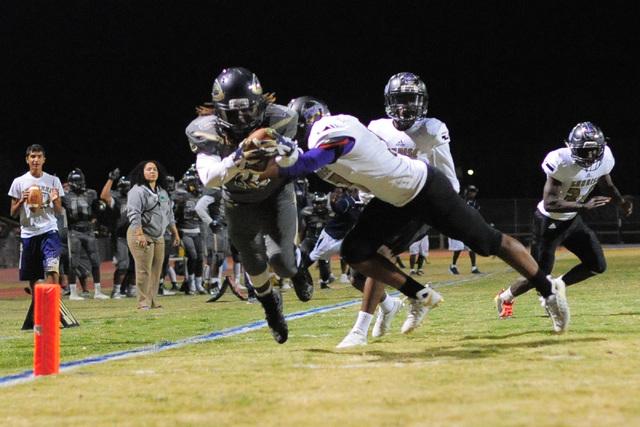 Cheyenne's Khalil McKenzie (10) scores a touchdown during the Cheyenne High School Sunrise Mountain High School game at Cheyenne High School in North Las Vegas on Friday, Oct. 21, 2016. Brett Le B ...