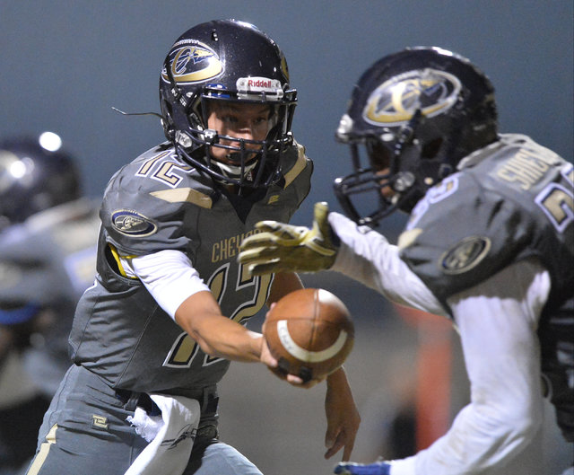 Cheyenne quarterback Matthew LaBonte (12) hands the ball off to Cajun Jackson (25) during the Cheyenne High School Sunrise Mountain High School game at Cheyenne High School in North Las Vegas on F ...