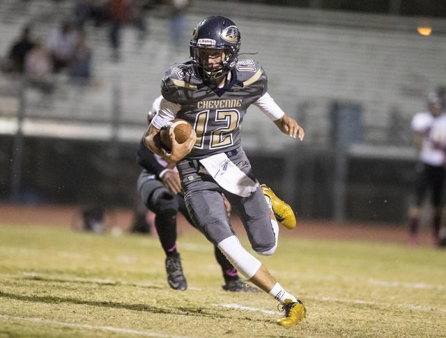 Cheyenne High School's Matthew LaBonte (12) runs the ball against Sunrise Mountain High School during a football game at Cheyenne High School in North Las Vegas on Friday, Oct. 21, 216. Loren Town ...