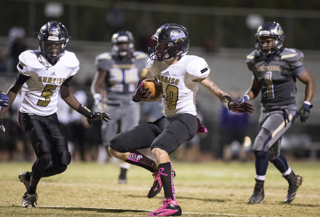 Sunrise Mountain High School's Daltyn Pytrysson (10) runs the ball against Cheyenne High School during a football game at Cheyenne High School in North Las Vegas on Friday, Oct. 21, 216. Loren Tow ...