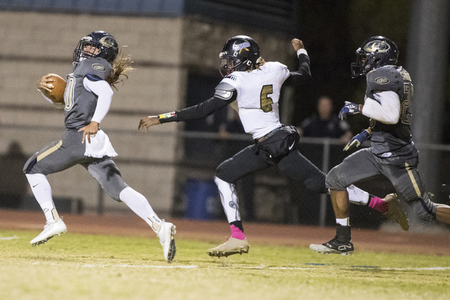 Joseph Kunicki (30) runs the ball against Sunrise Mountain High School during a football game at Cheyenne High School in North Las Vegas on Friday, Oct. 21, 216. Cheyenne High School wins 51- 49.  ...