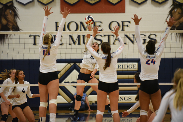 Shadow Ridge's Whittnee Nihipali (15), center, spikes the ball against Bishop Gorman defenders from left, Abby Archambault (13), Paige Poggione (7), and Alex Washington (24) during their volleybal ...