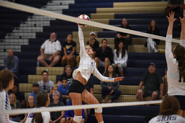 Bishop Gorman's Hannah Karl (4) spikes the ball against Shadow Ridge's defense during their volleyball match played at Shadow Ridge's gym in Las Vegas on Tuesday, Aug. 30 2016. Shadow Ridge defeat ...