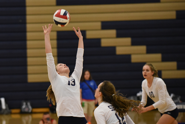 Shadow Ridge's Autumn Spendlove (13), left, sets the ball against Bishop Gorman during their volleyball match played at Shadow Ridge's gym in Las Vegas on Tuesday, Aug. 30 2016. Shadow Ridge defea ...