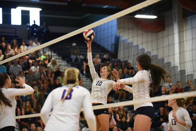 Shadow Ridge's Stacy Hone (10) tips the ball against Bishop Gorman defenders during their volleyball match played at Shadow Ridge's gym in Las Vegas on Tuesday, Aug. 30 2016. Shadow Ridge defeated ...