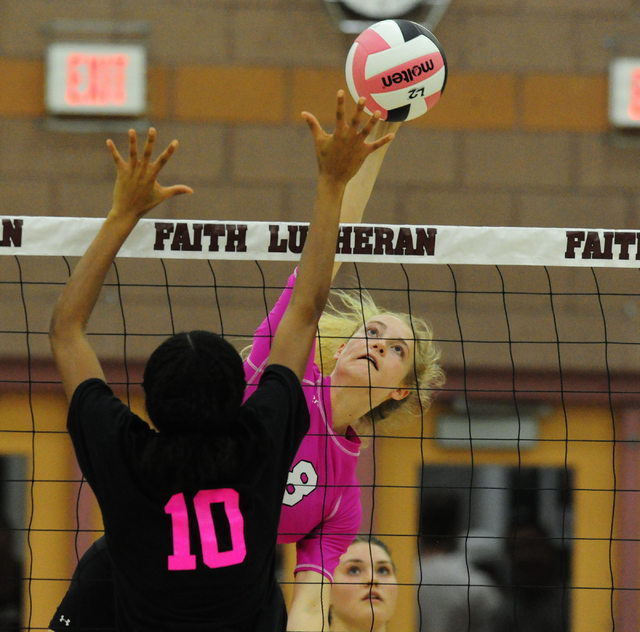 Faith Lutheran's Bryanna Neagle (8) kills the ball against Palo Verde during their prep volleyball match at Faith Lutheran High School in Las Vegas, Tuesday, Oct. 25, 2016. Josh Holmberg/Las Vegas ...