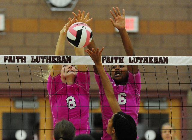 Faith Lutheran's Bryanna Neagle (8) and Sydney Washington (6) block the ball against Palo Verde during their prep volleyball match at Faith Lutheran High School in Las Vegas, Tuesday, Oct. 25, 201 ...