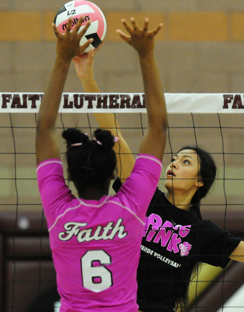 Palo Verde's Aaliah Largusa spikes the ball against Faith Lutheran's Sydney Washington (6) during their prep volleyball match at Faith Lutheran High School in Las Vegas, Tuesday, Oct. 25, 2016. Jo ...