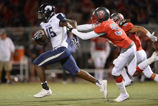 Shadow Ridge running back Malik Lindsey (15) runs the football during the Arbor View High School Shadow Ridge High School game at Arbor View in Las Vegas is seen on Friday, Sept. 30, 2016. Brett L ...