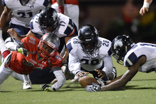 Players dive for a loose football during the Arbor View High School Shadow Ridge High School game at Arbor View in Las Vegas is seen on Friday, Sept. 30, 2016. Brett Le Blanc/Las Vegas Review-Jour ...