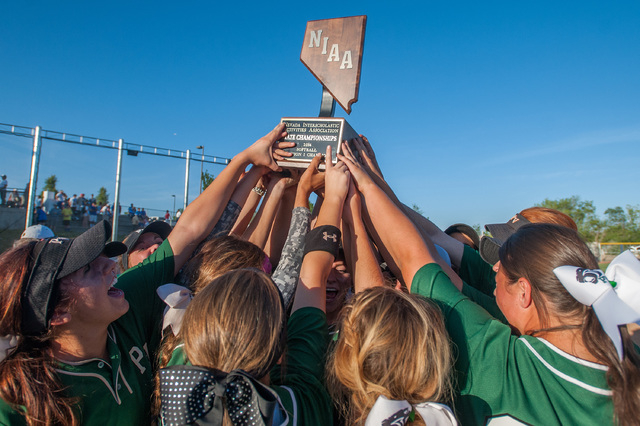 Palo Verde players hold up the state championship trophy after defeating Reed 12-8 Saturday for the Division I state title. (Kevin Clifford/Special to the Review-Journal)
