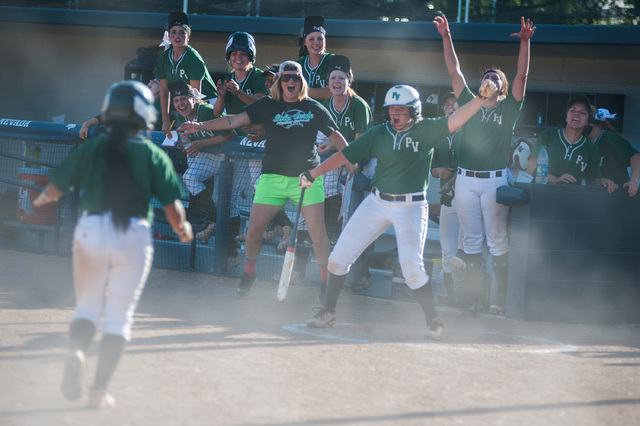 Palo Verde's Melissa Lacro runs through dust to her dugout after scoring against Reed in the deciding game of the Division I state softball on Saturday. Palo Verde won the game 12-8 to win the sta ...