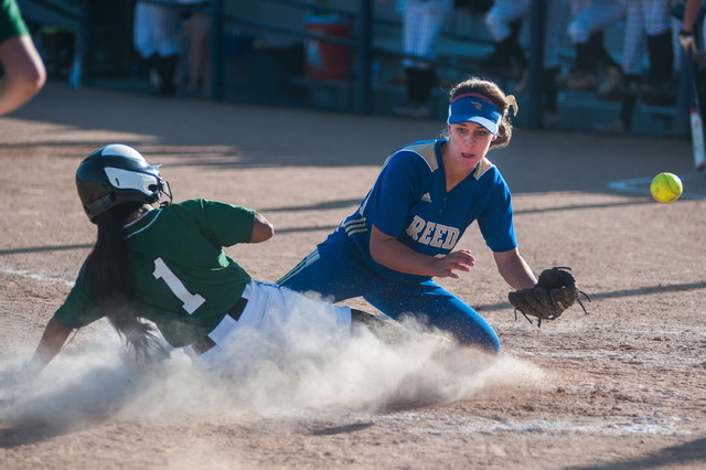 Palo Verde's Melissa Lacro slides home and scores as Reed's Jessica Sellers waits for the throw in the deciding game of the Division I state softball tournament on Saturday. Palo Verde won the gam ...