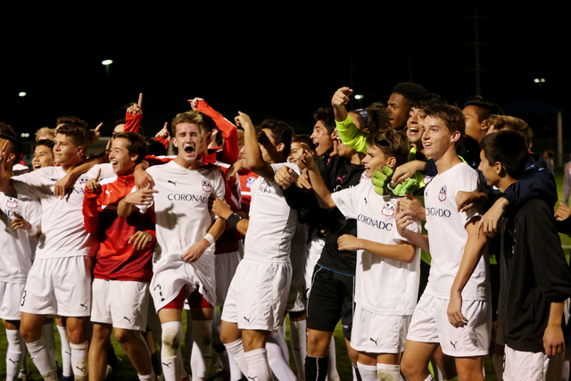 Coronado Cougars soccer team celebrate at the Bettye Wilson Soccer complex where the Cougars won the neutral playoff game against the Durango Trailblazers by a score of 3-2, Friday Nov. 11, 2016,  ...