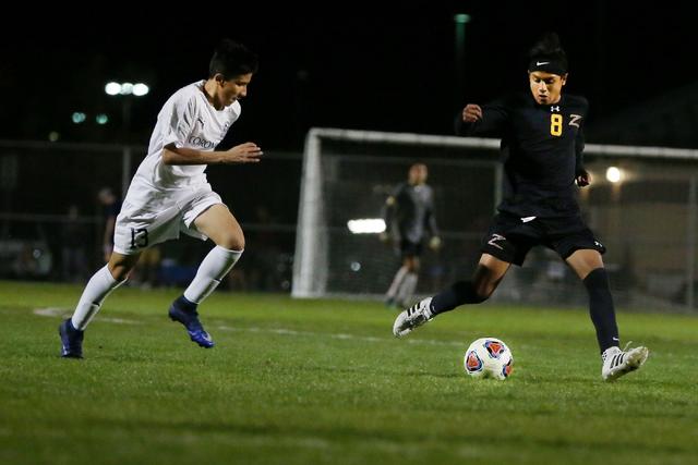 Durango's Erick Martinez Rodriguez (8) kicks the ball against Coronado at the Bettye Wilson Soccer complex during the neutral playoff game Friday, Nov. 11, 2016, in Las Vegas. Coronado defeated Du ...