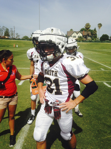 Faith Lutheran safety Tyler Mahan takes a break during the Fresno State football camp, while donning a Guardian Cap on his helmet. (Courtesy Vernon Fox)
