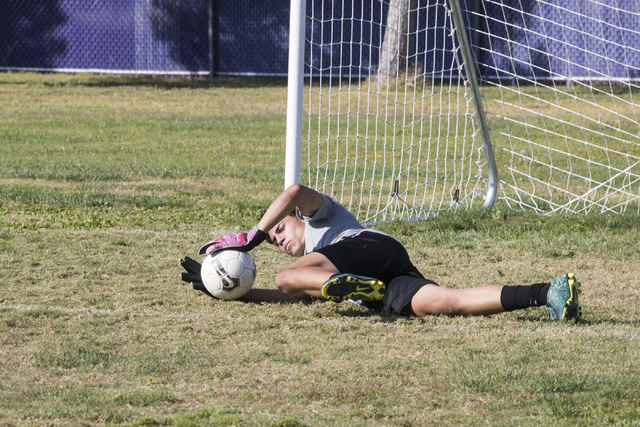 Paolo Sarnataro (23) dives for a ball during soccer practice at Durango High School in Las Vegas on Tuesday, Oct. 25, 2016. Loren Townsley/Las Vegas Review-Journal Follow @lorentownsley